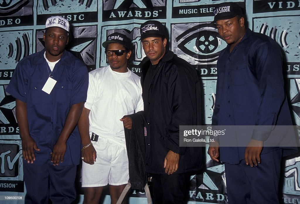 M.C. Ren, Eazy-E, guest and Dr. Dre of N.W.A. attend Eighth Annual MTV Video Music Awards on September 5, 1991 at the Universal Ampitheater in Universal City, California.