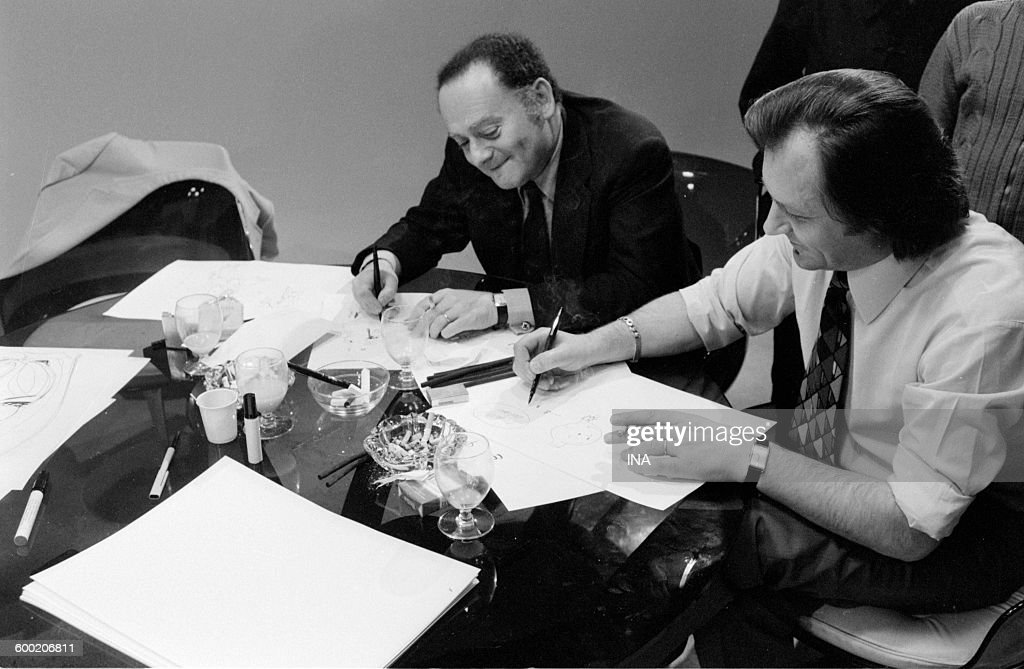 René Goscinny and Albert Uderzo drawing during the recording of the television program 'As quick as a flash'