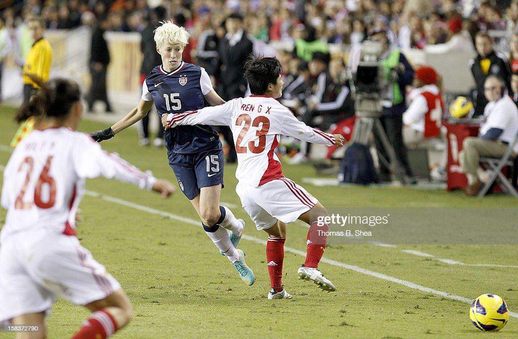 Ren Guixin midfielder #23 of the China Women's National Team holds Megan Rapinoe #15 of the U.S. Women's National Team in an international friendly game at BBVA Compass Stadium on December 12, 2012 in Houston, Texas. USA won 4 to 0.