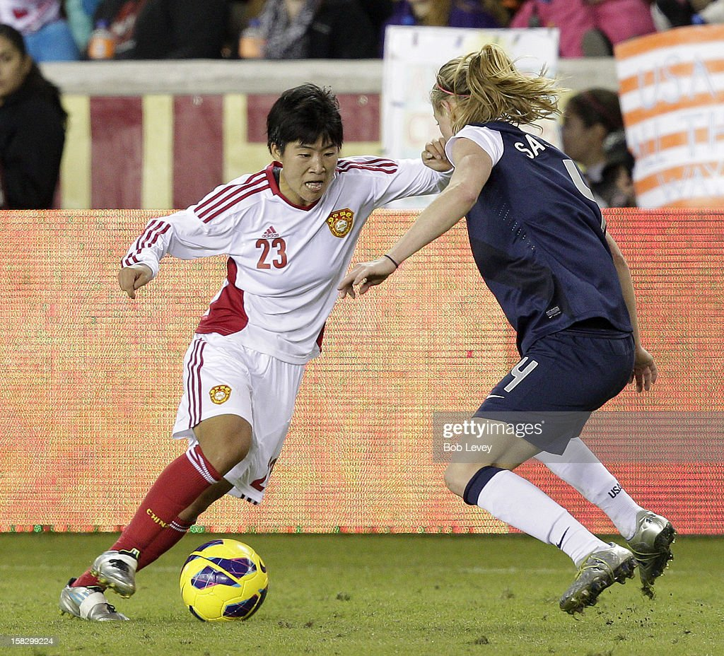 Ren Guixin (23) of China attempts to get around Beck Sauerbrunn (4) of the United States in the second half at BBVA Compass Stadium on December 12, 2012 in Houston, Texas. USA won 4-0.