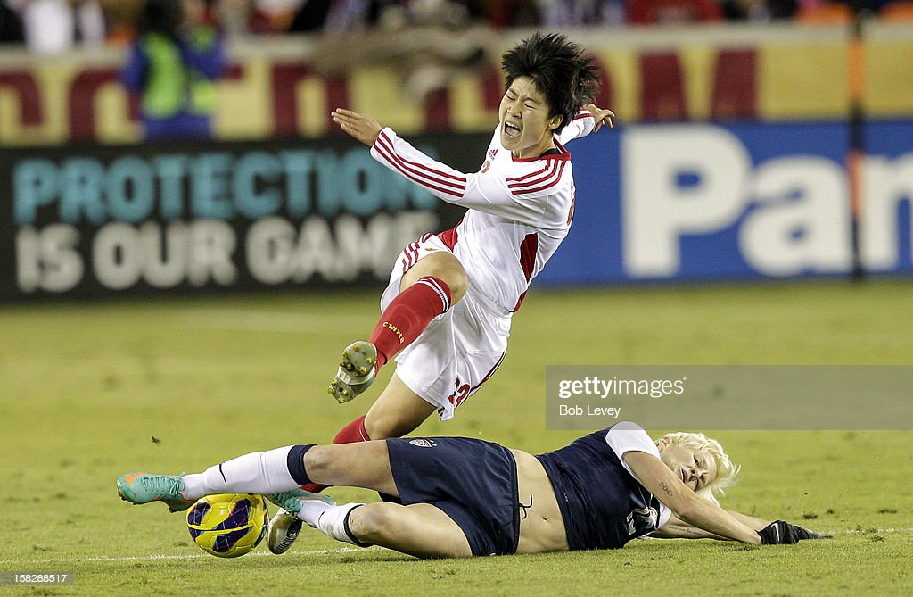 Ren Guixin #23 of China is upended by <a gi-track='captionPersonalityLinkClicked' href=/galleries/search?phrase=Megan+Rapinoe&family=editorial&specificpeople=736784 ng-click='$event.stopPropagation()'>Megan Rapinoe</a> #15 of the United States in the second half at BBVA Compass Stadium on December 12, 2012 in Houston, Texas. USA won 4-0.