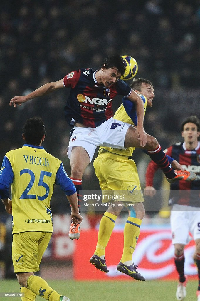 Renè Khrin # 4 of Bologna FC ( L ) heads the ball over Luca Rigoni # 16 of AC Chievo Verona ( R ) during the Serie A match between Bologna FC and AC Chievo Verona at Stadio Renato Dall'Ara on January 12, 2013 in Bologna, Italy.