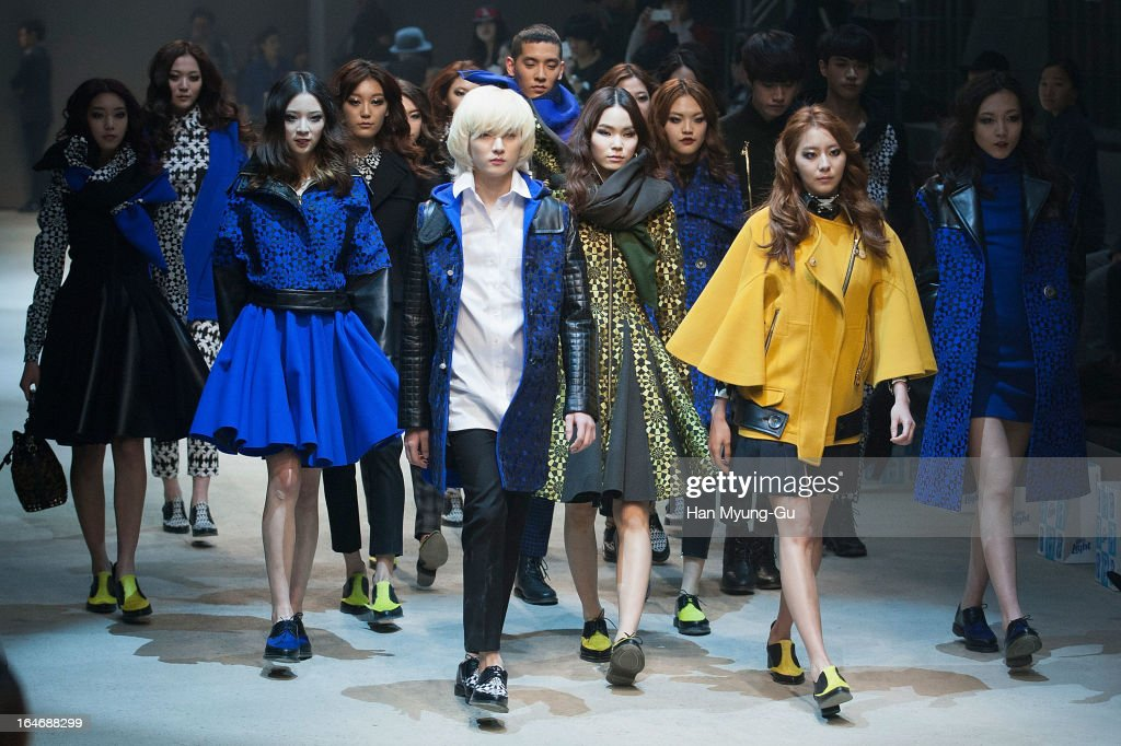 Ren of South Korean boy band NU'EST and U-ie (Kim You-Jin) of South Korean girl group After School walk on the runway at the 'BIG PARK' show on day two of the Seoul Fashion Week F/W 2013 at IFC Seoul on March 26, 2013 in Seoul, South Korea.