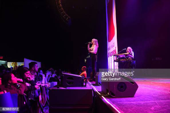 Rena Lovelis and Miranda Miller of the band Hey Violet perform on stage during Z100 CocaCola All Access Lounge at Z100's Jingle Ball 2016 Presented...