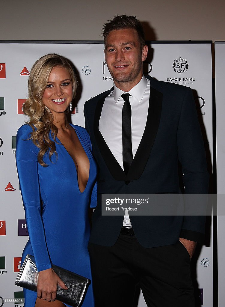 Renae Ayris and Essendon AFL player Tom Bellchambers arrive at the 2013 Miss Universe Australia Pageant on July 12, 2013 in Melbourne, Australia.