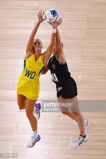 Renae Hallinan of Australia and Liana Leota of New Zealand compete for the ball during the gold medal netball match between Australia and New Zealand...