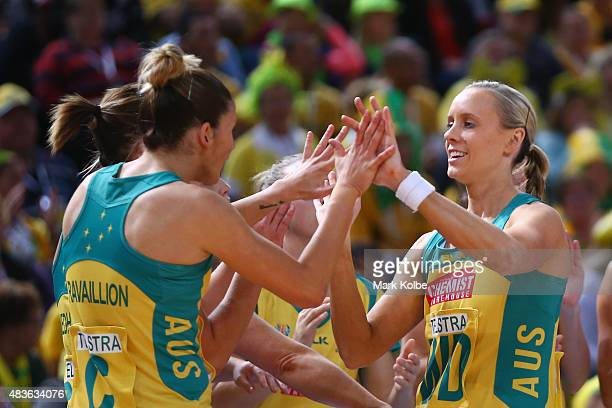 Renae Hallinan of Australia high fives her team mates as she take the court during the 2015 Netball World Cup Qualification round match between...