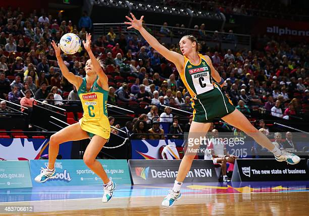 Renae Hallinan of the Diamonds is challenged by Erin Burger of South Africa during the 2015 Netball World Cup Qualification round match between...