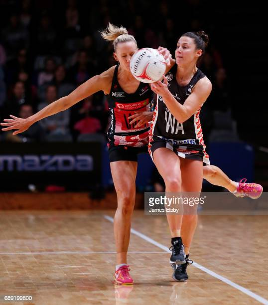 Renae Ingles of the Thunderbirds clashes with Madi Robinson of the Magpies during the round 14 Super Netball match between the Thunderbirds and...