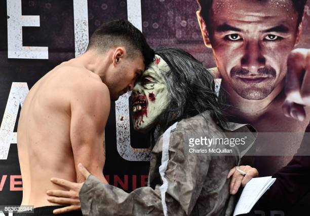Renald Garrido of France wearing a halloween costume goes head to head with Tyrone McKenna of Northern Ireland at the weigh in for the Ryan Burnett v...