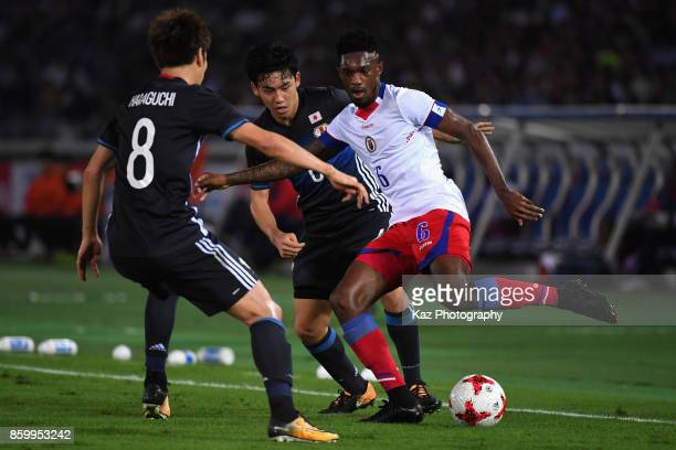 Renald Metelus of Haiti competes for the ball against Wataru Endo and Genki Haraguchi of Japan during the international friendly match between Japan...