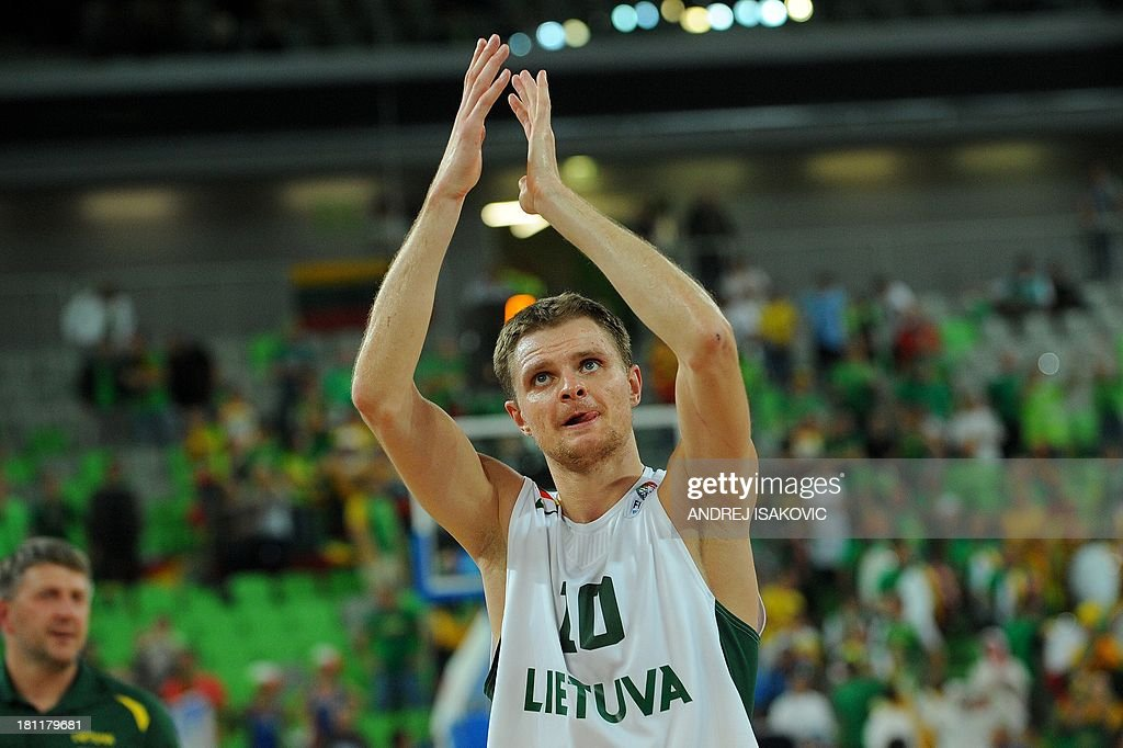 Renaldas Seibutis of Lithuania greets the supporters after the FIBA Eurobasket quarter final match between Lithuania and Italy at the Stozice Arena in Ljubljana, on September 19, 2013. AFP PHOTO / ANDREJ ISAKOVIC