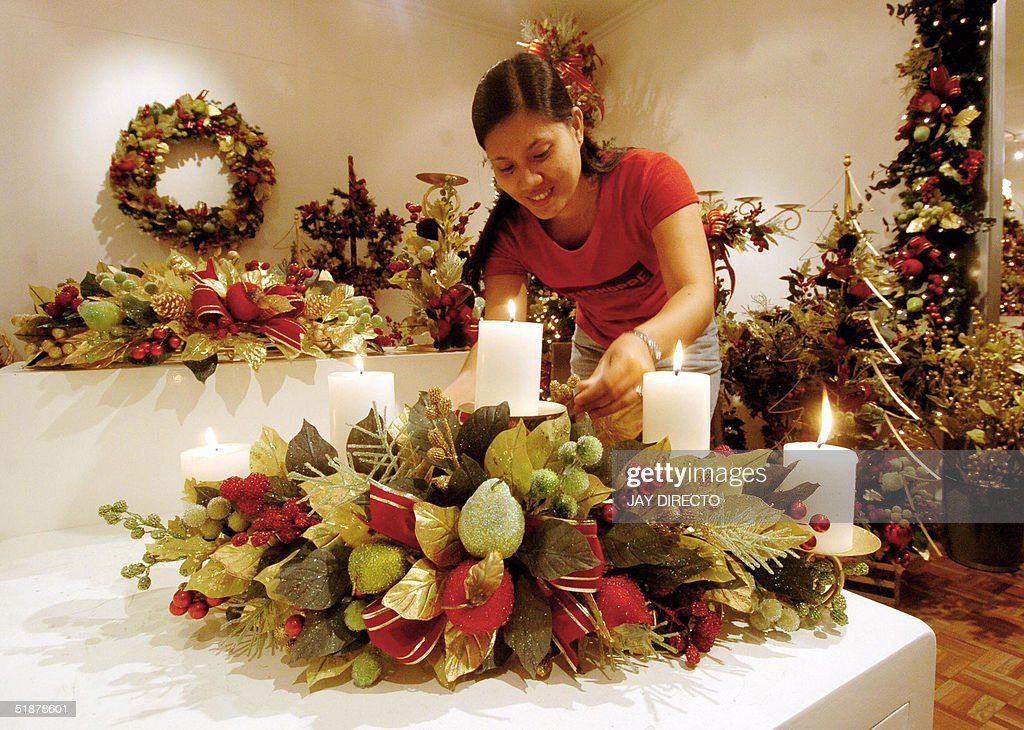 Economy 39 renalyn a worker at tamilee decors prepares a for Purchase christmas decorations