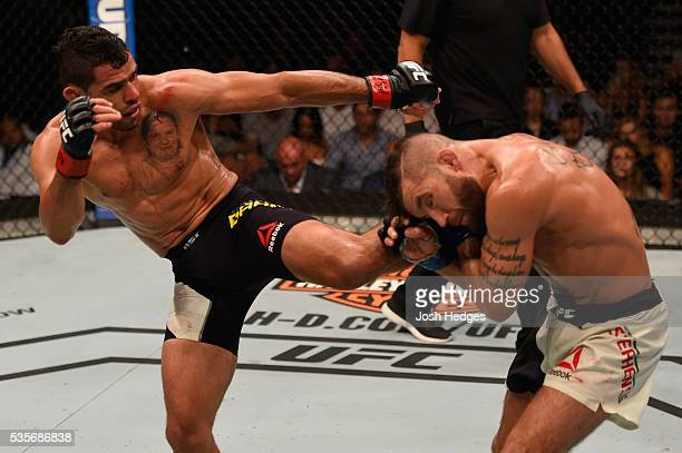 Renan Barao of Brazil kicks Jeremy Stephens in their featherweight bout during the UFC Fight Night event inside the Mandalay Bay Events Center on May...