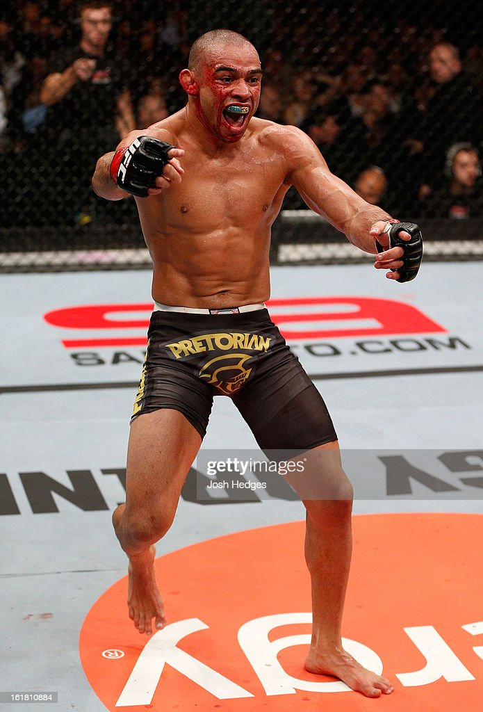Renan Barao reacts after defeating Michael McDonald in their interim bantamweight title fight during the UFC on Fuel TV event on February 16, 2013 at Wembley Arena in London, England.