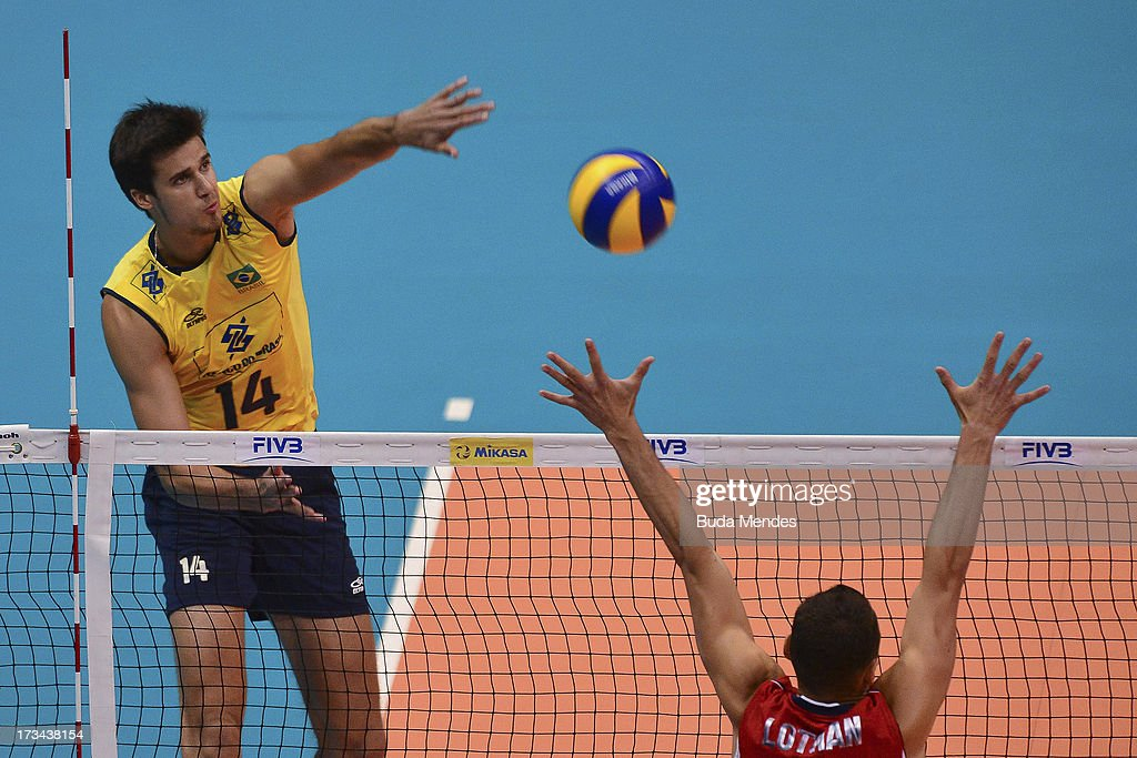 Renan (L) of Brazil in action against USA during a match between Brazil and USA as part of the FIVB Volleyball World League 2013 at the Maracanazinho gymnasium on July 14, 2013 in Rio de Janeiro, Brazil.
