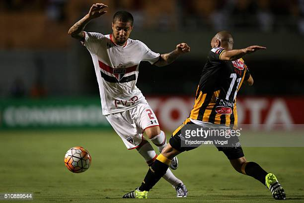 Renan Ribeiro of Sao Paulo fights for the ball with Ernesto Cristaldo of The Strongest during a match between Sao Paulo v The Strongest as part of...