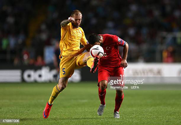 Renat Abdulin of Kazakhstan tackles Arda Turan of Turkey during the UEFA EURO 2016 Qualifier between Kazakhstan and Turkey at the Central Stadium on...