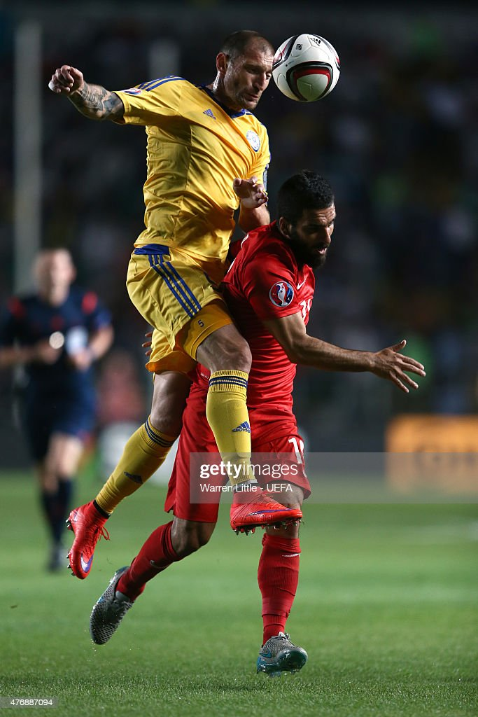 Renat Abdulin of Kazakhstan tackles <a gi-track='captionPersonalityLinkClicked' href=/galleries/search?phrase=Arda+Turan&family=editorial&specificpeople=2179402 ng-click='$event.stopPropagation()'>Arda Turan</a> of Turkey during the UEFA EURO 2016 Qualifier between Kazakhstan and Turkey at the Central Stadium on June 12, 2015 in Almaty, Kazakhstan.