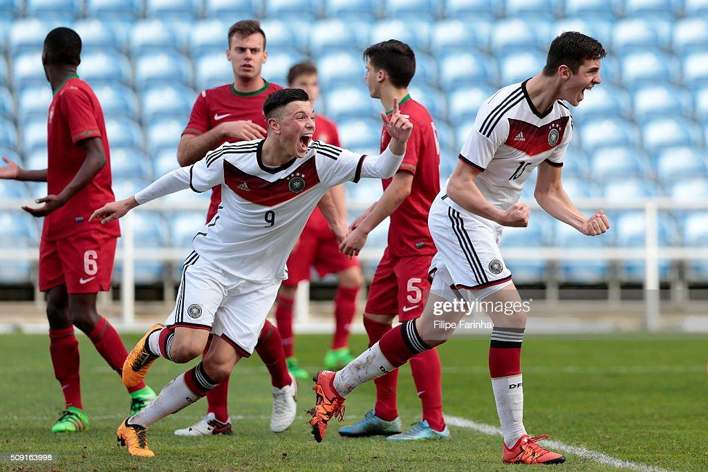 Renat Dadashov and Sven Sonnenberg of Germany celebrate a goal during the UEFA Under17 match between U17 Portugal v U17 Germany on February 9, 2016 in Estádio Algarve, Loulé, Portugal.