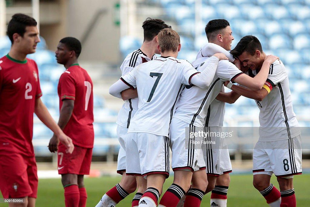 Renat Dadashov, Sven Sonnenberg and Atakan Akkaynak of Germany celebrate a goal during the UEFA Under17 match between U17 Portugal v U17 Germany on February 9, 2016 in Estádio Algarve, Loulé, Portugal.