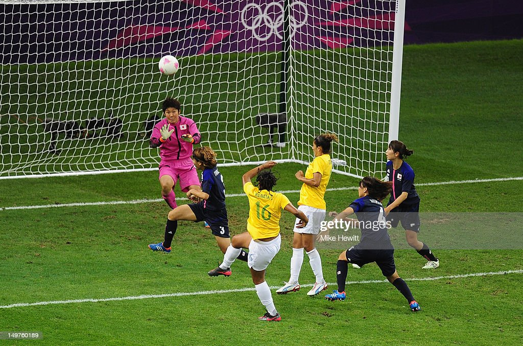 Renata Costa of Brazil blasts a shot over the bar as goalkeeper <a gi-track='captionPersonalityLinkClicked' href=/galleries/search?phrase=Miho+Fukumoto&family=editorial&specificpeople=4043871 ng-click='$event.stopPropagation()'>Miho Fukumoto</a> of Japan loos on during the Women's Football Quarter Final match between Brazil and Japan, on Day 7 of the London 2012 Olympic Games at Millennium Stadium on August 3, 2012 in Cardiff, Wales.