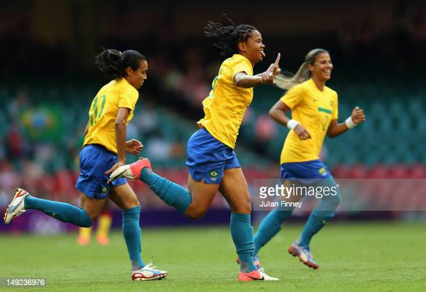 Renata Costa of Brazil celebrates scoring a header during the Women's Football first round Group E Match of the London 2012 Olympic Games between...