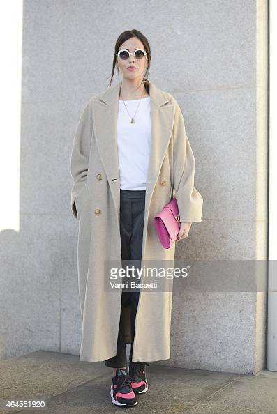 Renata Di Pace poses wearing a Max Mara coat YSL bag and Nike shoes on February 26 2015 in Milan Italy