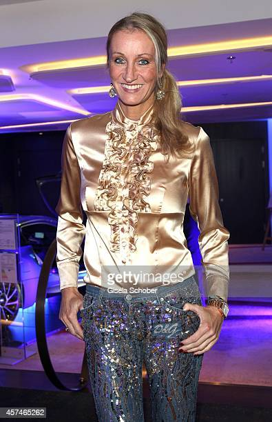 Renata Kochta wearing Jeans of Dolce Gabbana blouse the Monti Memorial Charity Gala at Hotel Vier Jahreszeiten on October 18 2014 in Munich Germany