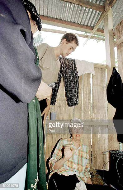 Renata Wellert Of Germany Sitting Speaks To Jolo Provincial Health Officer Doctor Nelson Amin May 1 2000 While Her Son Mark Looks On They Are Being...