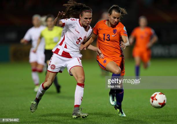 Renate Jansen of the Netherlands is tackled by Simone Boye Sorensen of Denmark during the UEFA Women's Euro 2017 Group A match between Netherlands...
