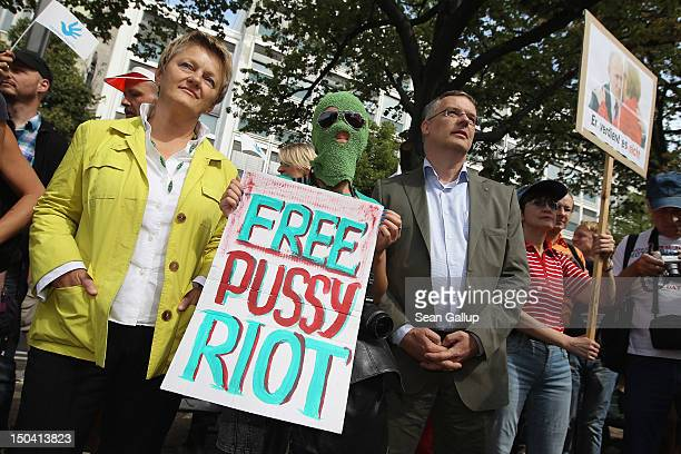 Renate Kuenast of the German Greens Party and Markus Loening German Federal Human Rights Commissioner join supporters of the Russian female punk band...