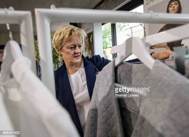 Renate Kuenast of the German Greens Party looks for fashion at Greenshowroom trade show during the MercedesBenz Fashion Week Berlin Spring/Summer...