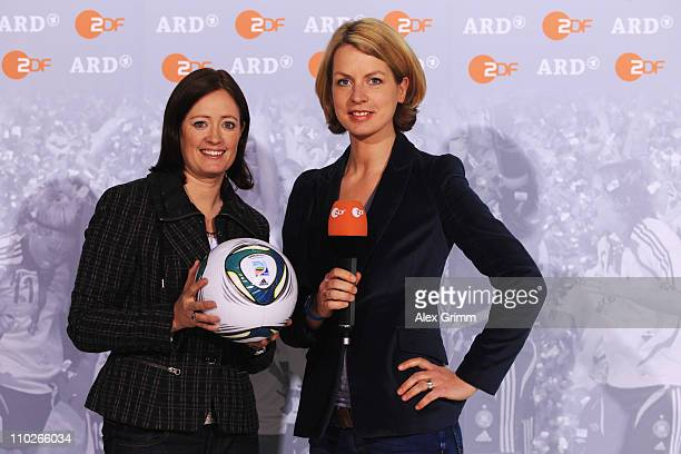 Renate Lingor and Jessy Wellmer pose during a photocall with the ARD and ZDF TV presenters for the FIFA Women World Cup 2011 at the Commerzbank Arena...