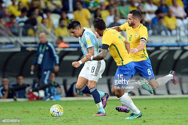 Renato Augusto and Paulinho of Brazil fight for the ball with Enzo Perez of Argentina during a match between Argentina and Brazil as part of FIFA...