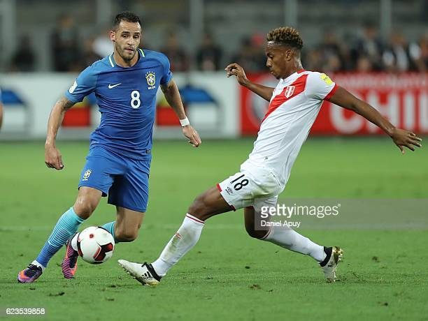 Renato Augusto fights for the ball Andre Carrillo during a match between Peru and Brazil as part of FIFA 2018 World Cup Qualifiers at Nacional...