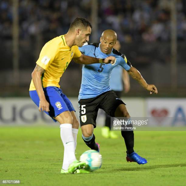 Renato Augusto of Brasil and Carlos Sanchez of Uruguay fight for the ball during a match between Uruguay and Brazil as part of FIFA 2018 World Cup...