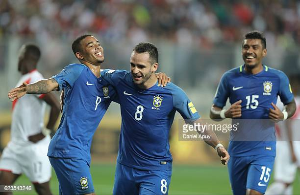 Renato Augusto of Brazil celebrates after scoring his team's second goal with teammate Gabriel Jesus during a match between Peru and Brazil as part...