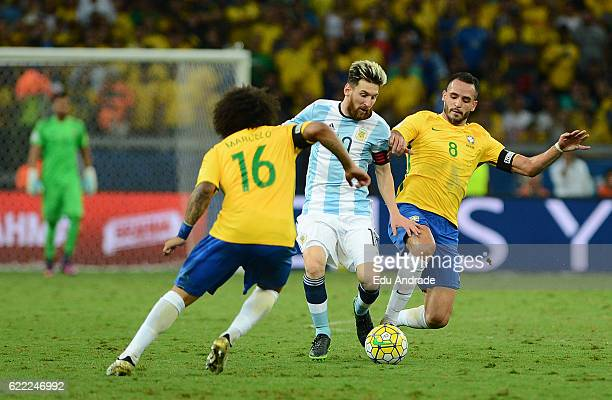 Renato Augusto of Brazil fights for the ball with Lionel Messi of Argentina during a match between Argentina and Brazil as part of FIFA 2018 World...