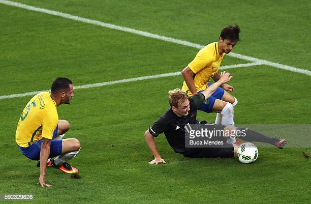 Renato Augusto of Brazil Julian Brandt of Germany and Rodrigo Caio of Brazil challenge for the ball during the Men's Football Final between Brazil...