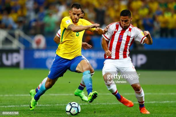 Renato Augusto of Brazil struggles for the ball with Bruno Valdez of Paraguay during a match between Brazil and Paraguay as part of 2018 FIFA World...