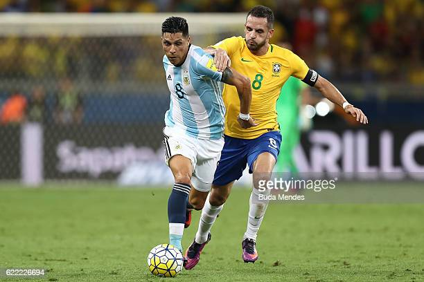 Renato Augusto of Brazil struggles for the ball with Enzo Perez of Argentina during a match between Brazil and Argentina as part of 2018 FIFA World...