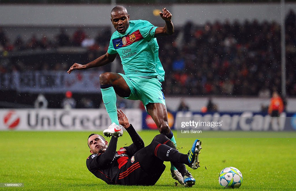 <a gi-track='captionPersonalityLinkClicked' href=/galleries/search?phrase=Renato+Augusto&family=editorial&specificpeople=4192762 ng-click='$event.stopPropagation()'>Renato Augusto</a> of Leverkusen challenges <a gi-track='captionPersonalityLinkClicked' href=/galleries/search?phrase=Eric+Abidal&family=editorial&specificpeople=469702 ng-click='$event.stopPropagation()'>Eric Abidal</a> of Barcelona during the UEFA Champions League round of 16 first leg match between Bayer 04 Leverkusen and FC Barcelona at BayArena on February 14, 2012 in Leverkusen, Germany.