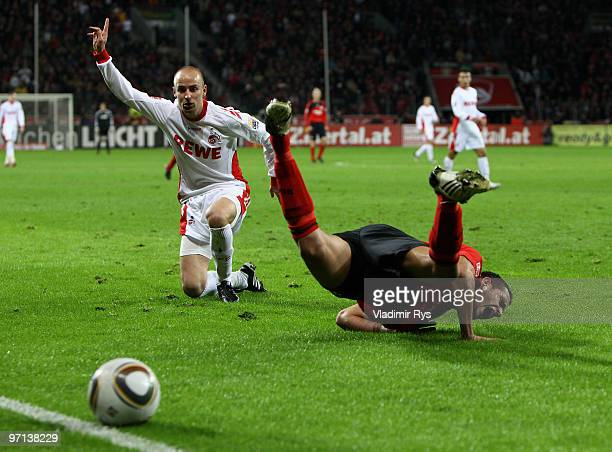Renato Augusto of Leverkusen falls after a battle with Miso Brecko of Koeln during the Bundesliga match between Bayer Leverkusen and 1 FC Koeln at...