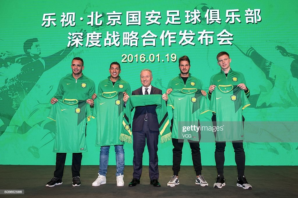 Renato Augusto, Ralf, head coach Alberto Zaccheroni, Kleber and Egor Krimets of Beijing Guoan attend a press conference on January 19, 2016 in Beijing, China.