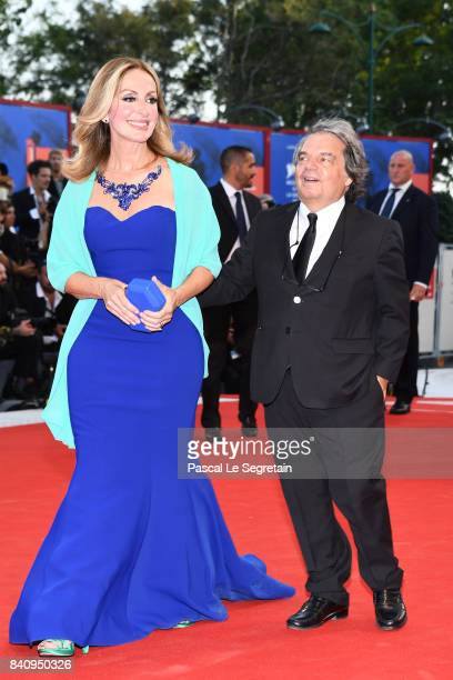 Renato Brunetta and Tommasa Giovannoni Ottaviani walk the red carpet ahead of the 'Downsizing' screening and Opening Ceremony during the 74th Venice...