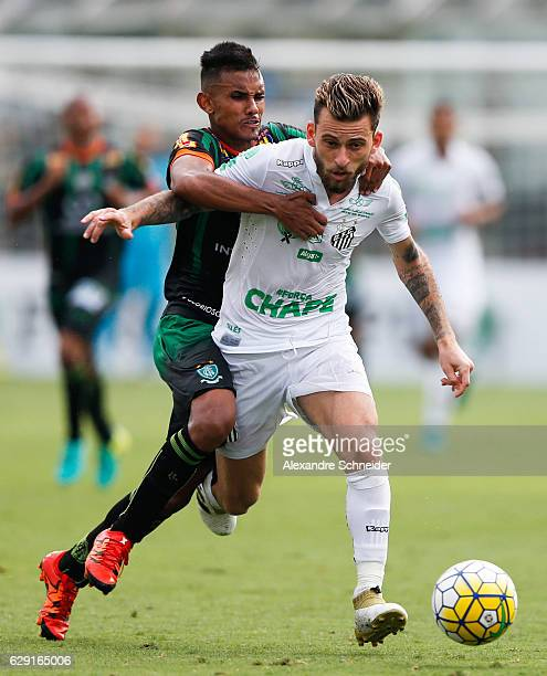 Renato Bruno of America MG and Lucas Lima of Santos in action during the match between Santos and America MG for the Brazilian Series A 2016 at Vila...