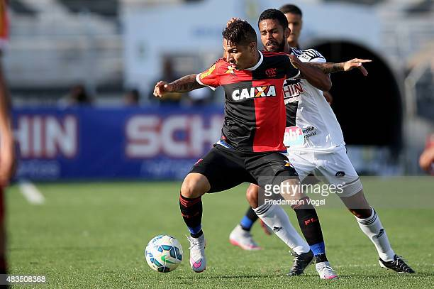 Renato Chaves of Ponte Preta fights for the ball with Guerrero of Flamengo during the match between Ponte Preta and Flamengo for the Brazilian Series...