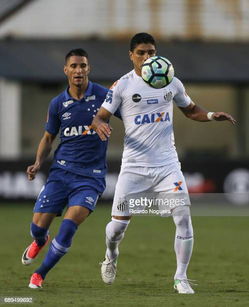 Renato Henrique of Santos battles for the ball with Thiago Neves of Cruzeiro during the match between Santos and Cruzeiro as a part of Campeonato...