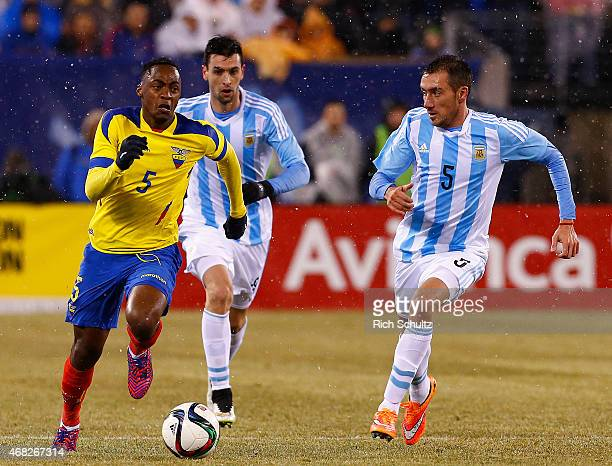 Renato Ibarra of Ecuador plays the ball ahead of Javier Pastore and Federico Mancuello of Argentina in the first half during an international...
